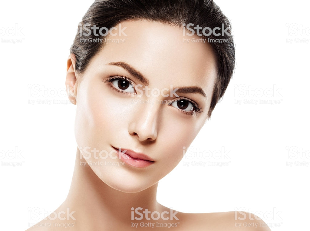 Beauty Woman face Portrait. Beautiful model Girl with Perfect Fresh Clean Skin. Brunette female looking at camera and smiling. Youth and Skin Care Concept. Isolated on a white background